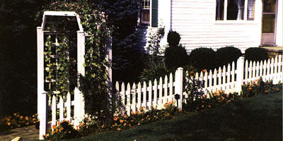 classic picket fence and arbor design by Elyria Fence