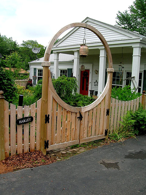 Wooden Halo Arching over a double gate by Elyria Fence Inc.