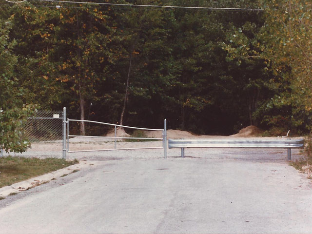 Commercial Barricade Gate With Steel Guard Rail Fence by Elyria Fence