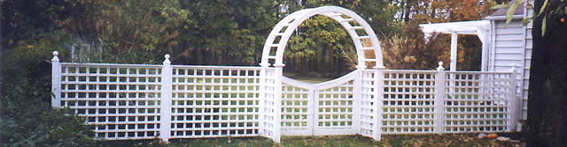 Square Lattice Fencing with an arbor by Elyria Fence