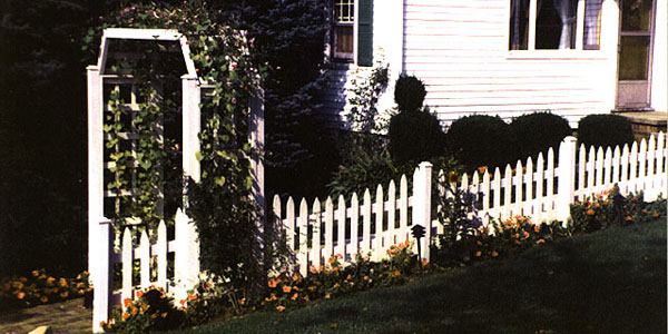 Reverse Runner Cedar Picket Fence with arbor built by Elyria Fence Company