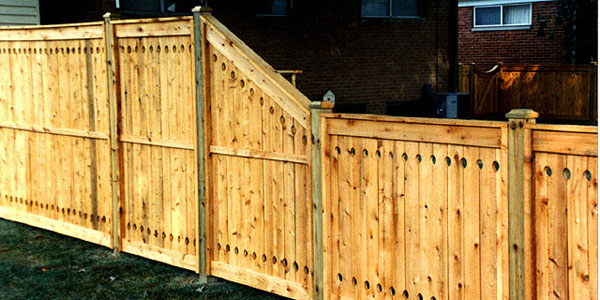 Good Neighbor Cedar Privacy Fencing with holes top and bottom by Elyria Fence