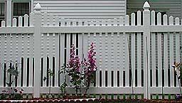 Vinyl spaced scalloped picket fence by Elyria Fence