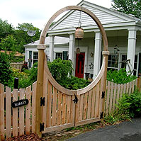 Wooden Halo over a double gate by Elyria Fence