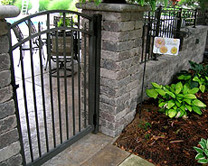 Ornamental aluminum, wrought iron arched gate by Elyria Fence