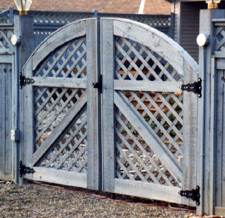 arched lattice wood gate by Elyria Fence