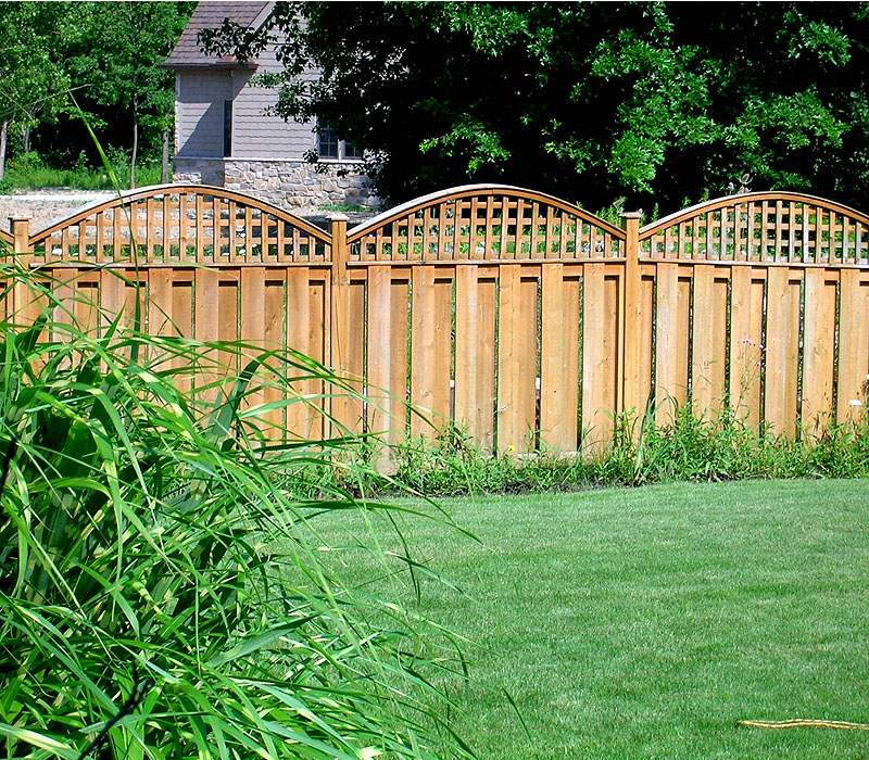 White Cedar Wood Shadowbox Fence with Arched Square Lattice by Elyria Fence