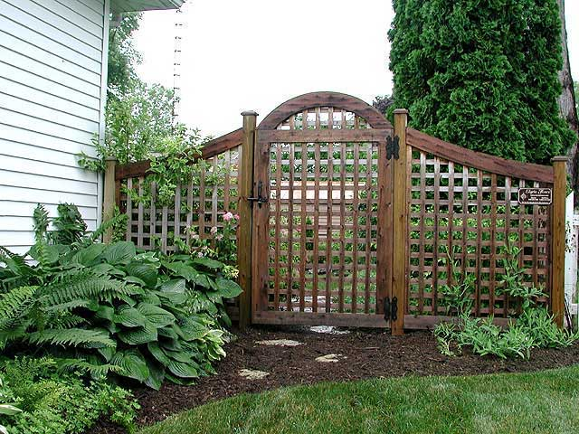 square lattice fence and arched gate by Elyria Fenc
