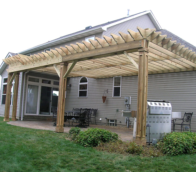 wood pergola with custom molding on the posts by Elyria Fence