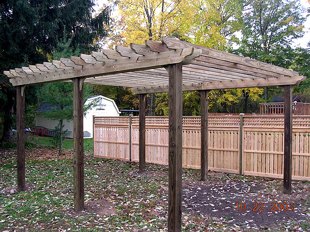 wood sun trellis with semi privacy fence by Elyria Fence