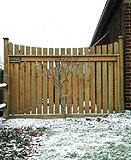 white cedar wood spaced sabre scallop fence by elyria fence