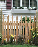 spaced white cedar wooden provincial fence with finial posts by elyria fence