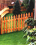 spaced white cedar wooden imperial picket fence by elyria fence