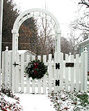 sabre scalloped white cedar wooden picket fence with arbor & gate by elyria fence
