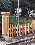 spaced scalloped white cedar wooden picket fence with boxed out post by elyria fence