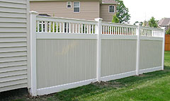 Vinyl two color privacy fence by Elyria Fence