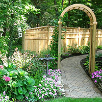garden arch with wood privacy fence