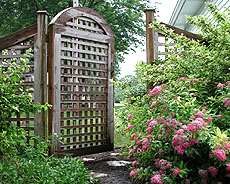 arched square lattice gate by Elyria Fence