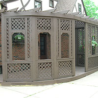 Wood Pergola With Diagonal Lattice by Elyria Fence