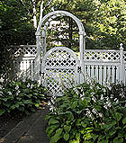 semi private wood fence with arched lattice gate and arbor by elyria fence