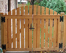 semi private arched gate by Elyria Fence