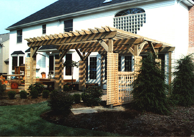 wood pergola with square lattice vine trellis